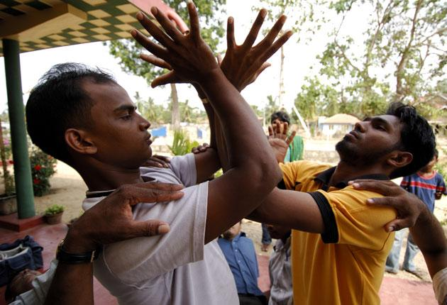 Young men take part in a trustbuilding exercise at a hotel in the Sri Lankan jungle