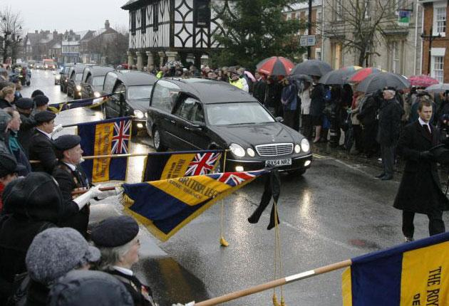 Hundreds of people line Wootton Bassett's high street regularly to watch servicemen's bodies being driven through from RAF Lyneham