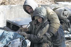 Strife in a slow vein: Viggo Mortensen and Kodi Smit-McPhee carry the 'dismal burden' of The Road