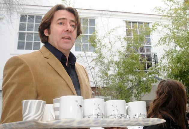 Jonathan Ross brings out cups of tea to the media outside his home in London after announcing his departure