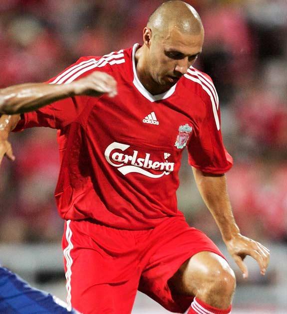 Dossena endured a torrid time at Anfield