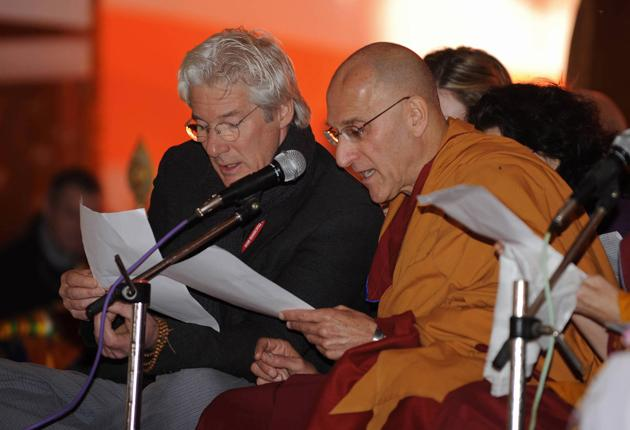 Richard Gere prays during the fourth day of a teaching session led by the Dalai Lama in Bodhgaya yesterday