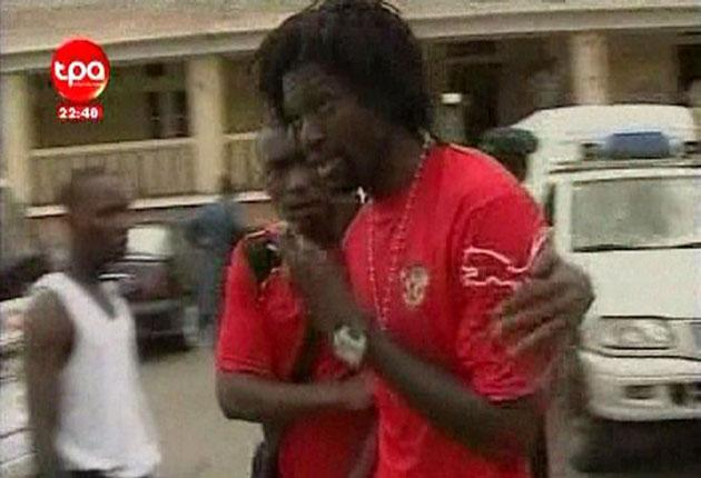 A video grab from Angolan TV shows Emmanuel Adebayor of Manchester City being comforted outside a hospital in Cabinda after the Togo bus was attacked.