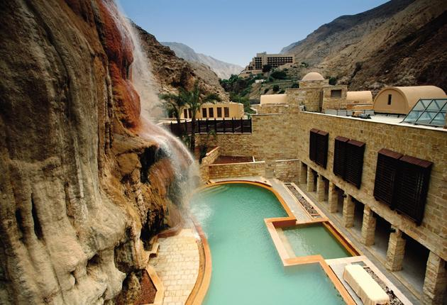 Healing waters: A sulphurous waterfall plunges from the clifftop above the main building, which is set in a canyon
