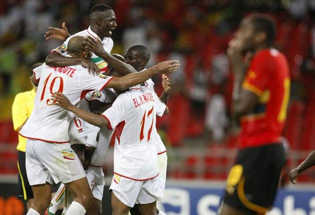Mali's players celebrate their extraordinary comeback in the opening match of the African Nations Cup last night