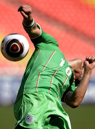 The Algeria striker Rafik Saifi misses the ball as his team flopped in their opening African Nations Cup match with Malawi