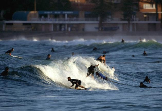 Surfers at Manly Beach in Sydney where manners have made waves