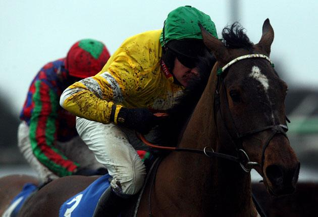 Mad Max, ridden by Barry Geraghty, is clear after the last in the Novices' Chase at Kempton yesterday