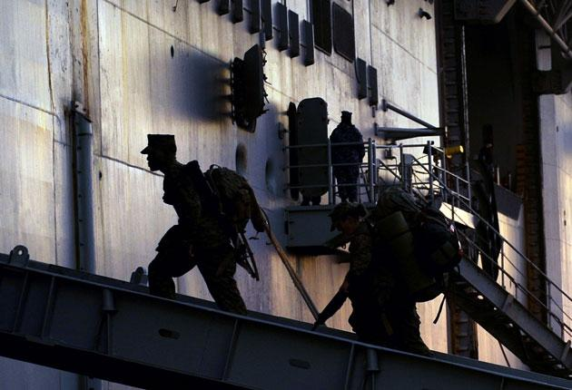 Marines board the USS 'Bataan', bound for Haiti. America pledged 5,000 troops, with more to follow