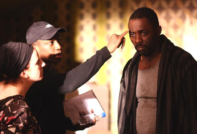 Idris Elba, the British actor who stars as a US serviceman in Legacy, is attended by make-up artist Niamh Morrison and director Thomas Ikimi
