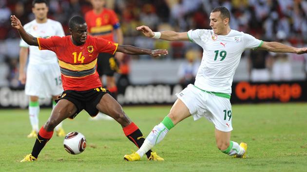 Djalma Campos (left), of Angola, tussles with Algeria's Hassen Yebda in their goalless draw in Luanda yesterday