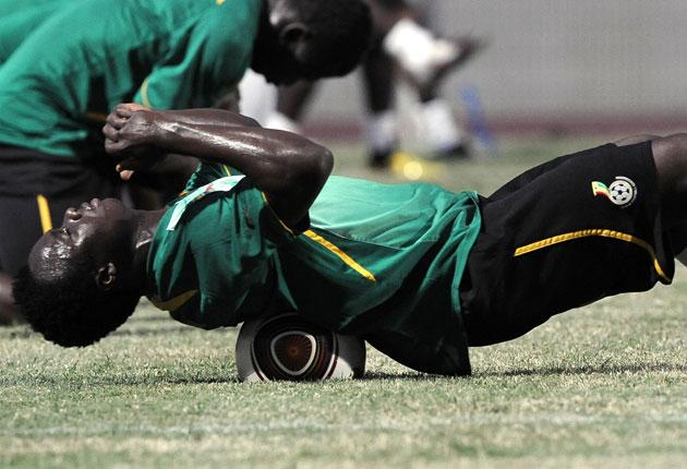 Ghana's Dominic Adiyiah stretches during training for the African Cup of Nations