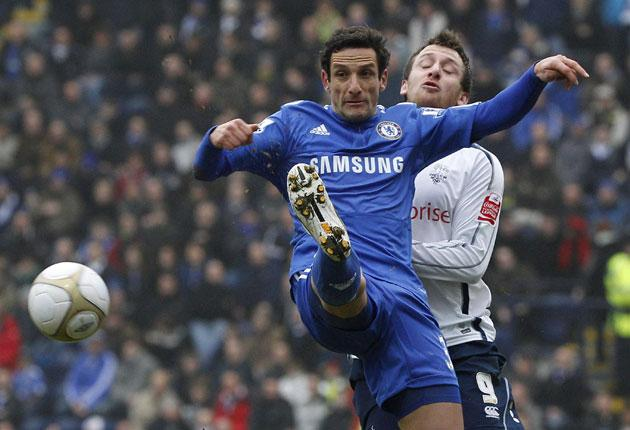 Preston North End's Chris Brown (right) challenges Juliano Belletti of Chelsea during a routine victory for the FA Cup holders at Deepdale
