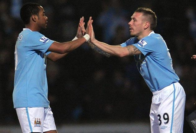 Robinho (left) is replaced by Craig Bellamy after what could prove to be his final outing for City