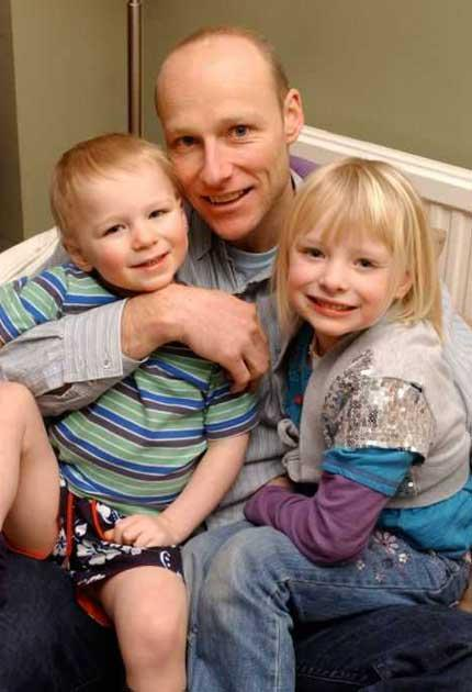 Lone father: Simon Valentine, with Henry and Alicia. His wife, Karen, died of cancer