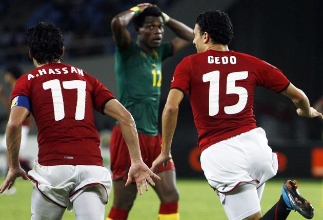 Egyptian scorers Gedo and Ahmed Hassan celebrate their victory over Cameroon yesterday
