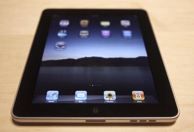 The Apple iPad, a new tablet computing device, sits on display