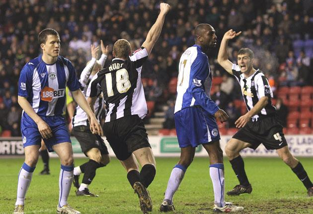 The Notts County players celebrate Stephen Hunt's  opening goal in last night's FA cup replay with Wigan