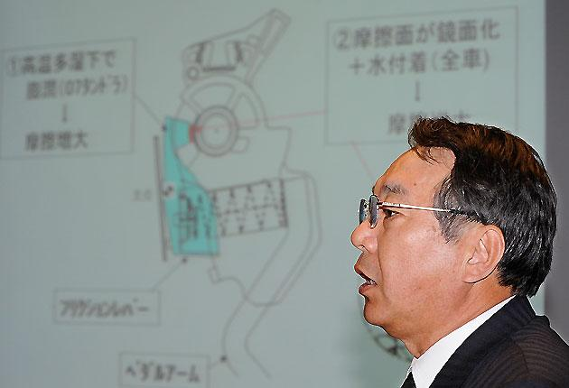 Executive Vice President of Toyota Motor Shinichi Sasaki explains about its accelerator pedal during a press conference at the headquarters in Nagoya, central Japan