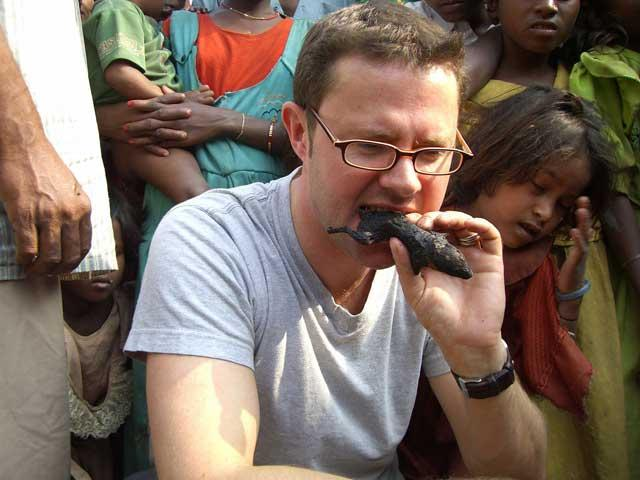 Food for thought: TV presenter Stefan Gates eats a rat in India