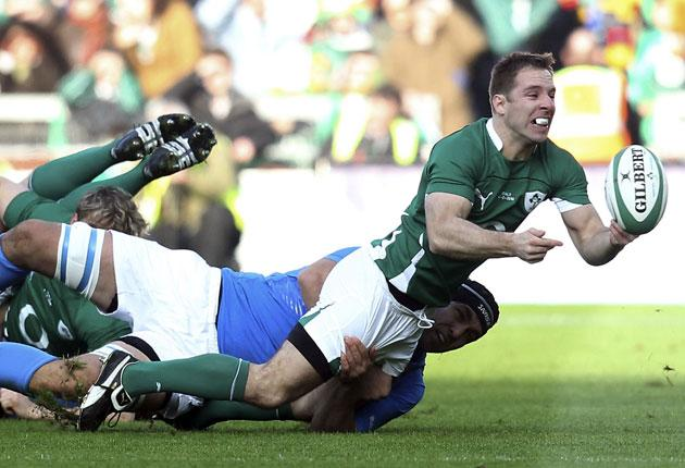 Tomas O'Leary gets the ball away despite Italian pressure during Ireland's victory at Croke Park
