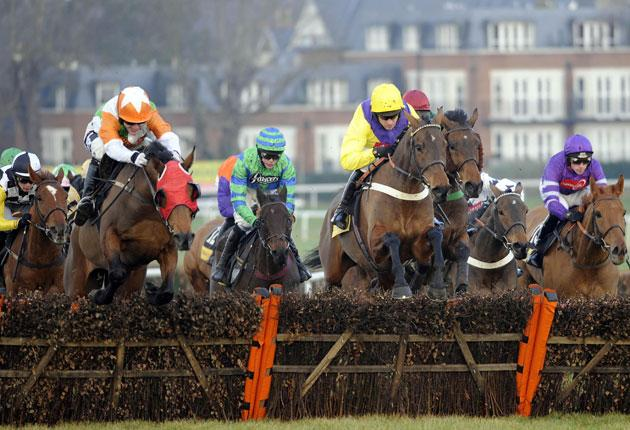 Harry Skelton on board Beshabar (far right) on their way to victory in the Heroes Handicap Hurdle at Sandown