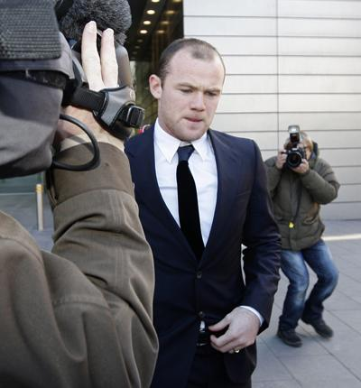 Wayne Rooney leaves court yesterday after giving evidence in the case