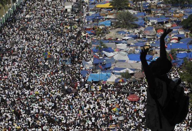 Thousands of survivors gathered across Haiti's capital, Port-au-Prince, to commemorate the 12 January  earthquake that killed 125,000 people