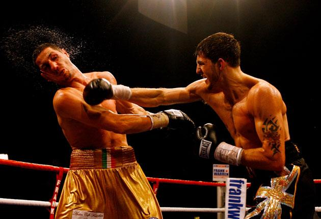 Nathan Cleverly (right) lands a right hand on Antonio Brancalion