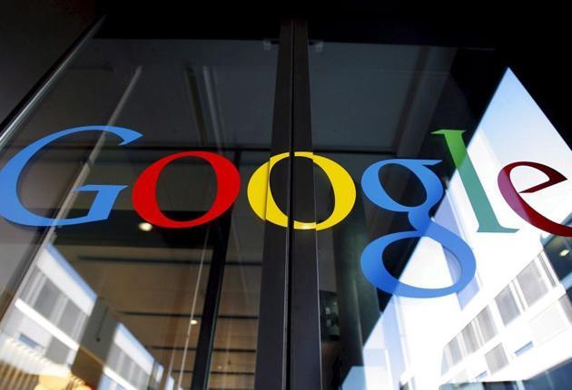 The logo of Google, seen on the front door of the new Google Engeneering center in Zurich