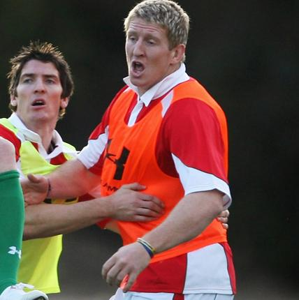 Bradley Davies (right) and James Hook take part in a Wales training session. Davies' mother died suddenly this week