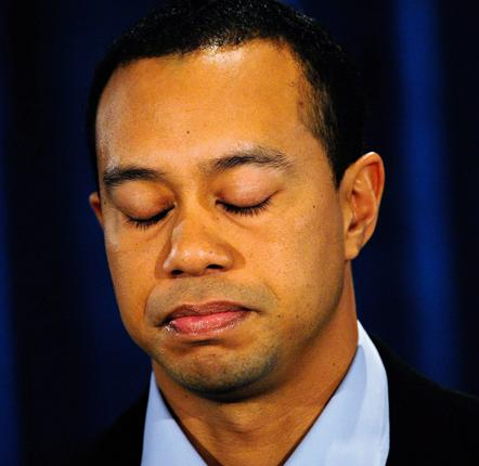 Tiger Woods shows the strain during his public apology in Florida yesterday