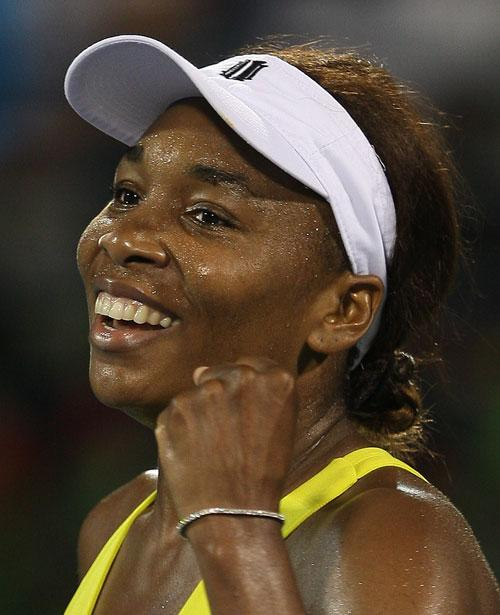 Venus Williams celebrates after winning the Dubai Tennis Championships