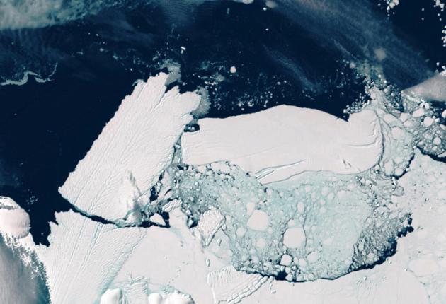 Satellite image of a 60-mile-long iceberg, right, crashing into the Mertz Glacier tongue in Antarctica