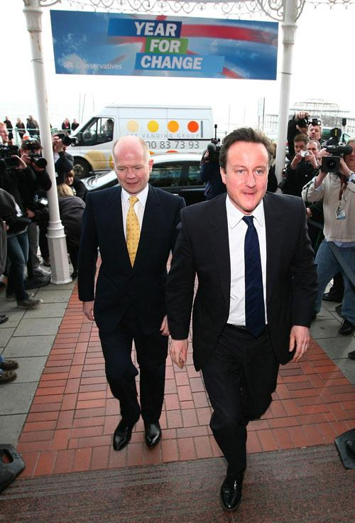 David Cameron arriving in Brighton with William Hague yesterday for the Conservative spring conference