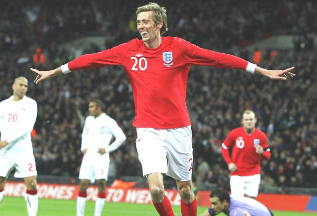 Peter Crouch celebrates his and England's first goal last night