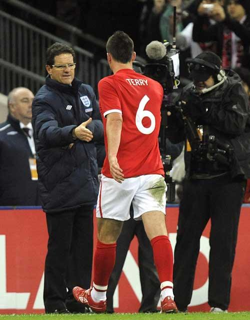 Fabio Capello shakes the hand of a forgiven John Terry on Wednesday, while Wayne Bridge remains in self-imposed exile