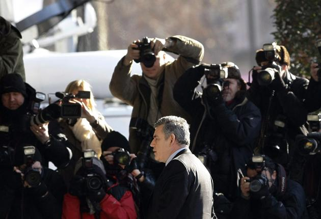 The Prime Minister walks past a scrum of photographers on his way into the Queen Elizabeth II Centre in Westminster to be questioned by the Chilcot inquiry yesterday
