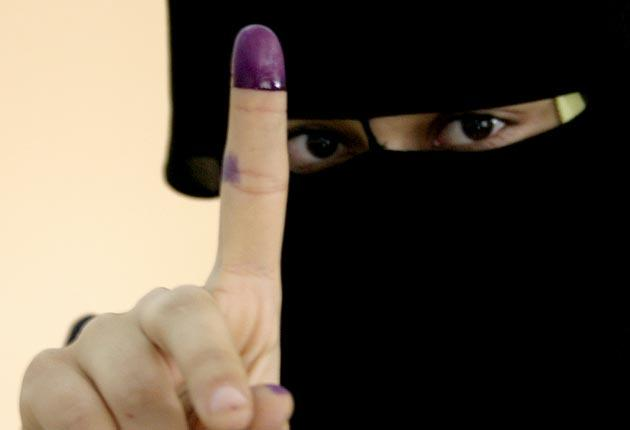 A woman with inked finger
