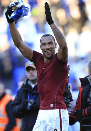 Aston Villa's John Carew salutes the fans after winning the club's FA Cup victory against Reading at the Madejski Stadium on Sunday