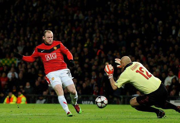 Wayne Rooney scores his and Manchester United's second goal last night