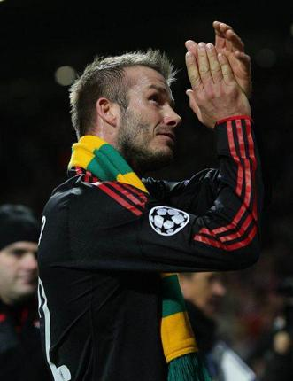 David Beckham grabs the headlines with his scarf gesture