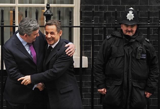 Gordon Brown embraces Nicolas Sarkozy outside No 10 yesterday. The French President also met the Conservative leader David Cameron later in the day