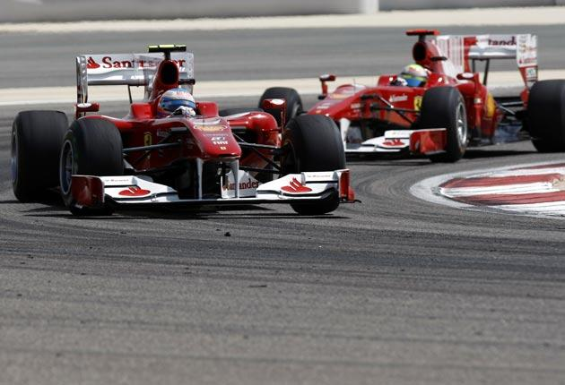 Ferrari's Fernando Alonso drives ahead of his Brazilian team mate Felipe Massa in their third practice session at Bahrain