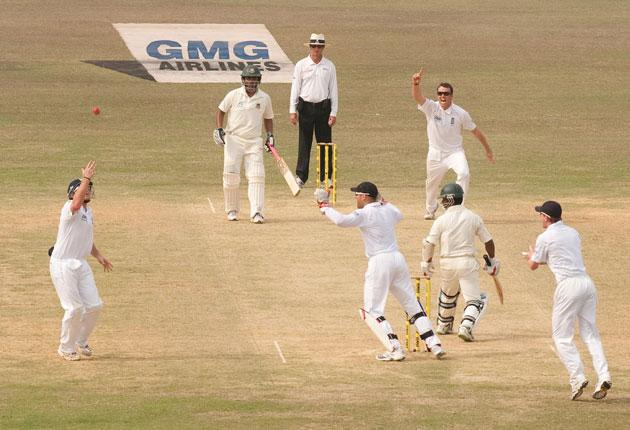 Graeme Swann celebrates as Ian Bell catches Bangladesh batsman Aftab Ahmed - astonishingly, it is the 12th time the England spinner has taken a wicket in his first over