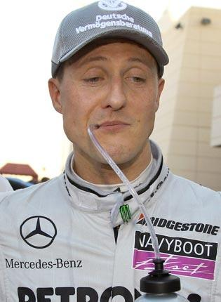 Michael Schumacher takes on fluids after the 41-year-old's comeback grand prix yesterday.