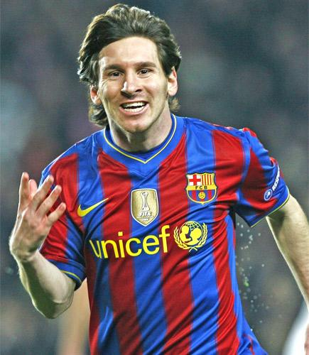 Leo Messi celebrates scoring his first goal during Barcelona's easy victory