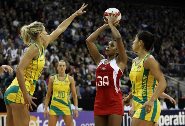England's Pamela Cookey, one of the few players allowed to, shoots against Australia during a recent Test in London
