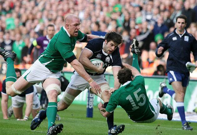 Johnnie Beattie, one of Scotland's back-row Killer Bs, powers through Ireland's defence to score a try