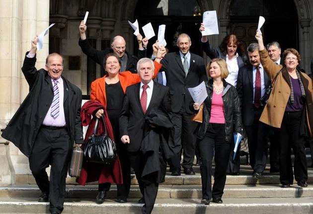 MPs and members of the anti-Heathrow expansion coalition group celebrate as they leave the High Court yesterday